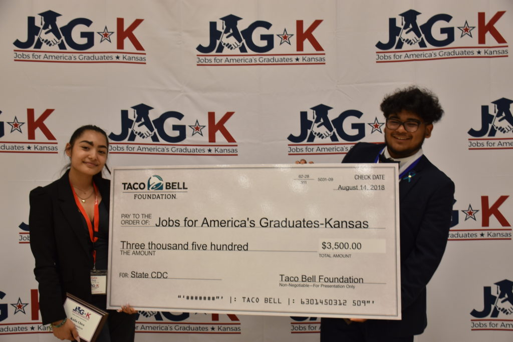 Two students holding giant check from Taco Bell Foundation grant